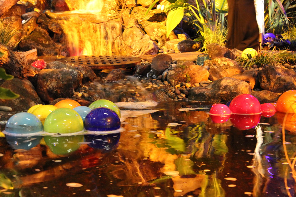 Floating balls of glass reflect water in this garden. photo by Holly Guenther